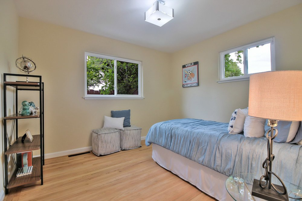 A bedroom after cleanup: note new paint and floor