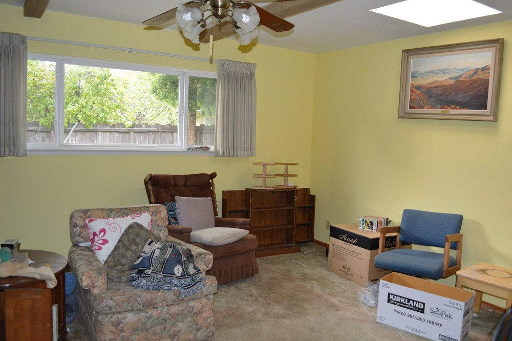 Family room before cleanup - note yellow walls