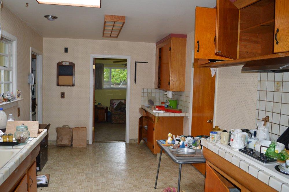 Kitchen before remodel - wood tone finish
