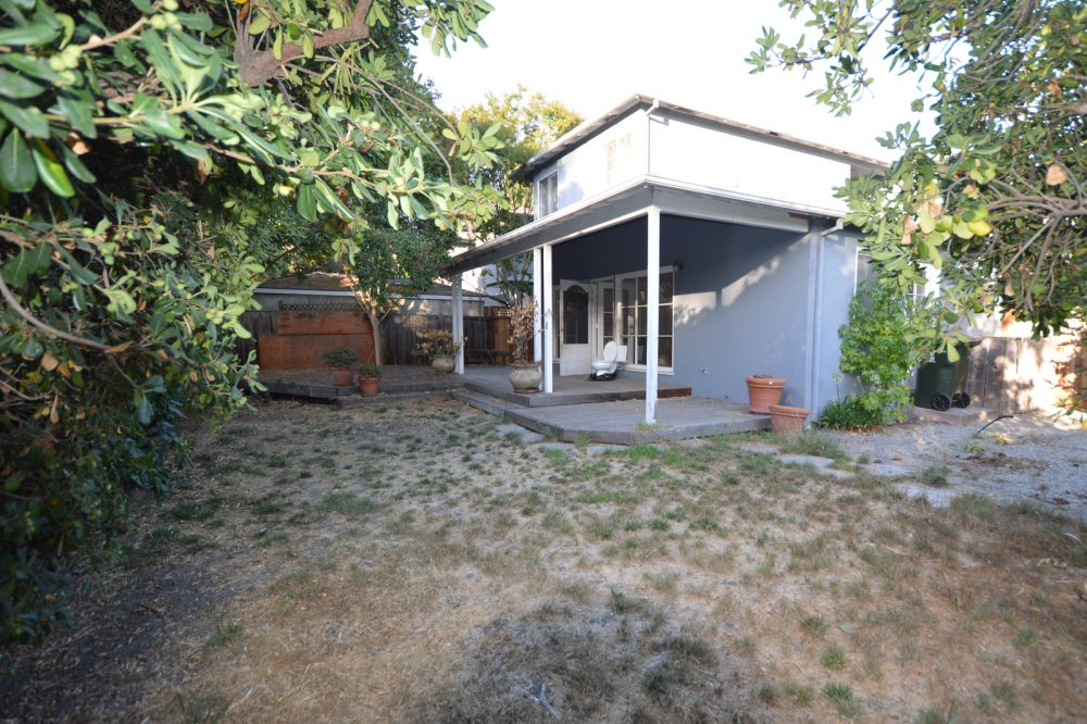 Back yard before remodel: note dry lawn